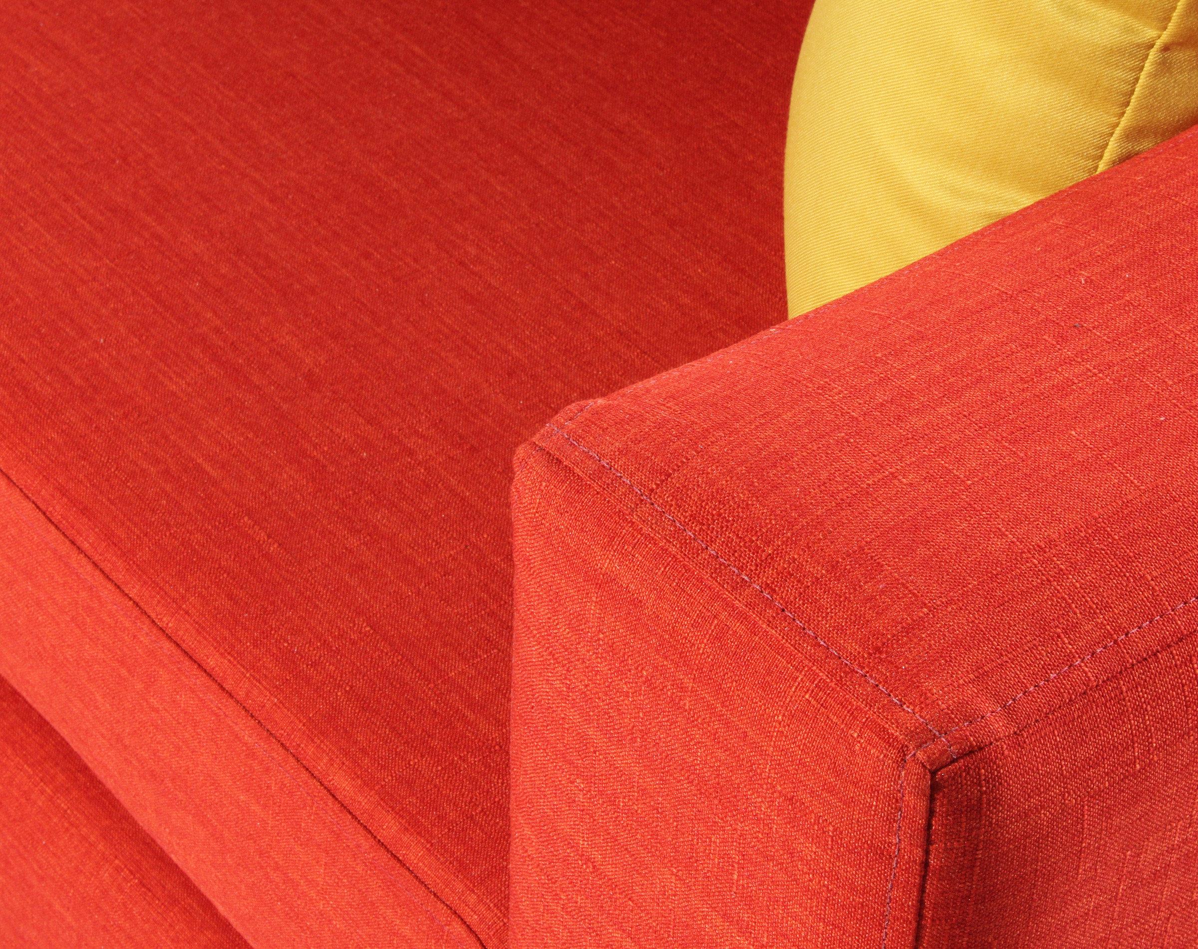 sofa-cama-urban-bariloche-naranjo-detalle-tapiz-y-brazo